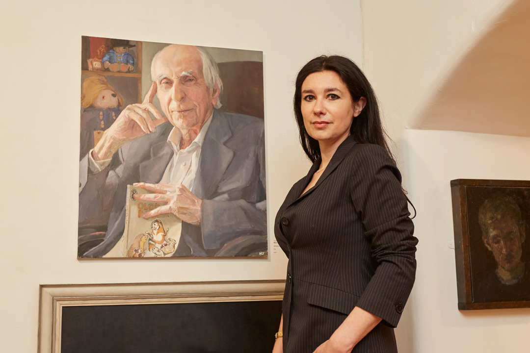 Hero Johnson with her portrait of Paddington Bear author Michael Bond