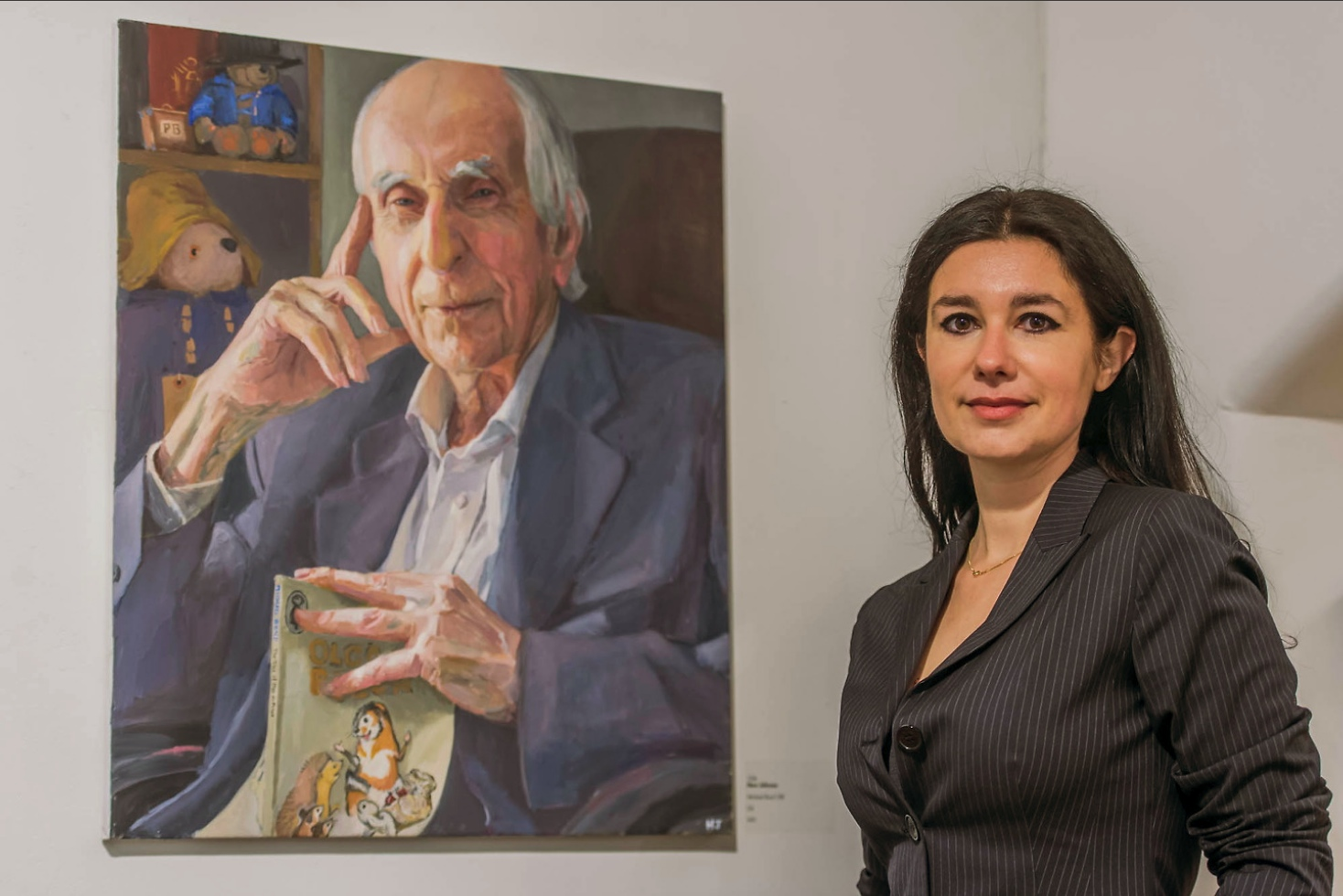 Hero Johnson with her painting of Michael Bond. Image copyright Guy Bell